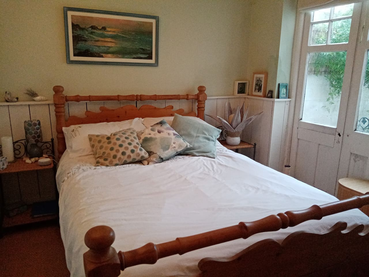 Double bedroom with French windows opening onto garden