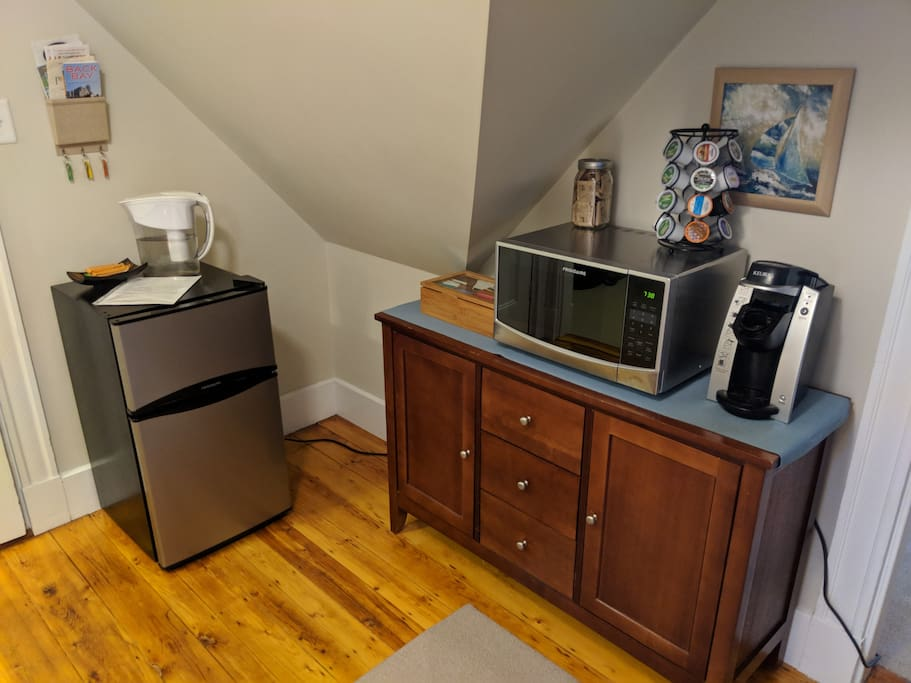 Fridge, microwave, tea, and coffee maker, with chest storing a toaster and electric kettle