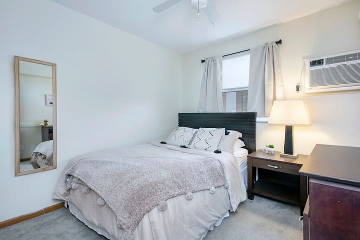 A comfortable queen bed to make yourself at home in Columbus! Dresser, closet, hangers, and iron provided.