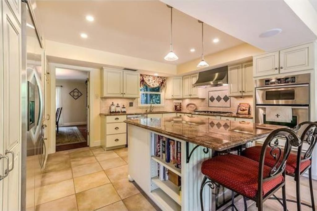 Fully equipped eat in kitchen with easy access to large in ground pool.
