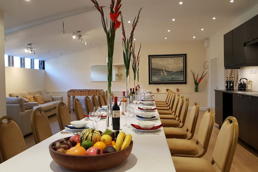 The Club Dining Room laid for a dinner party for 20.