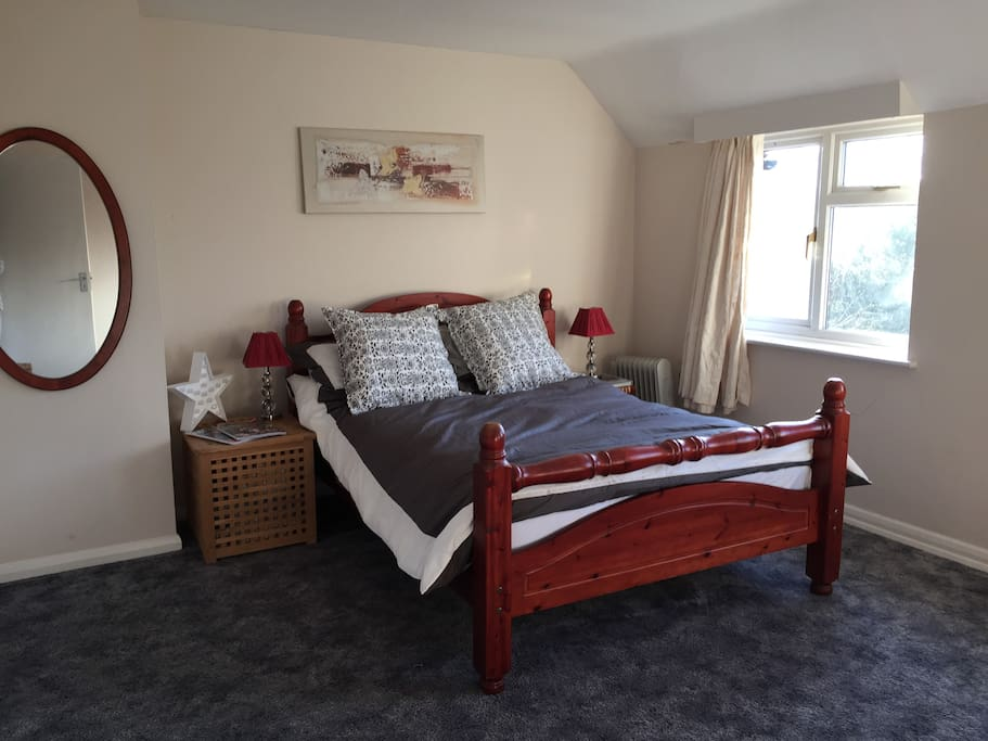Comfortable double bed in sunny room