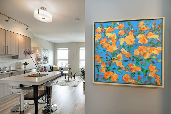 Welcome to our Stunning Urban Oasis. The condo is warm and inviting and features vibrant original works of art by a talented local artist.