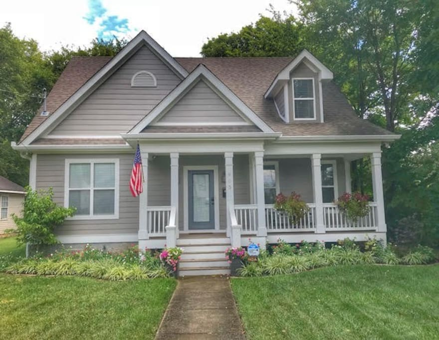 Newer traditional home with modern finishes. Relax on the front porch.