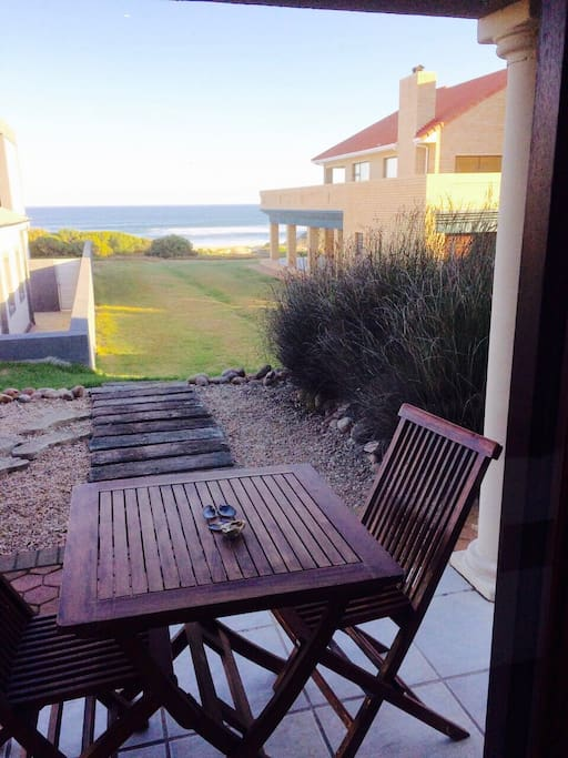Direct access to beach with outside patio.