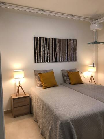 Master bedroom With two motorbeds