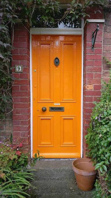 You can't really miss the front door - it's the only orange one in the street!