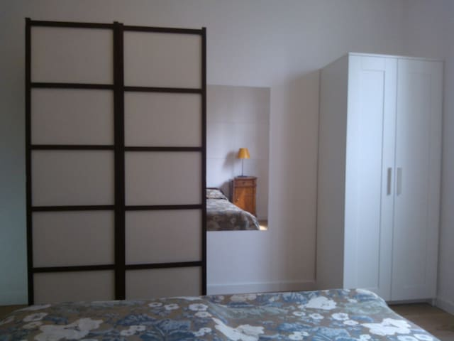 Two ample wardrobes and large chest of drawers. There is also a shoes holder and frame for jackets.