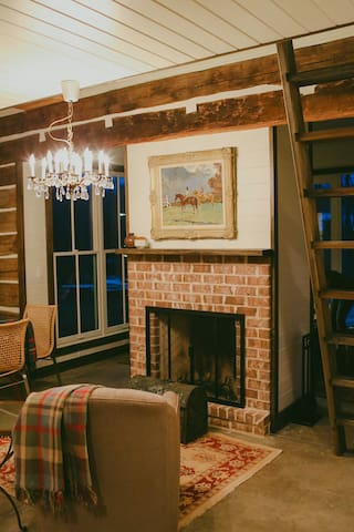 Fireplaces on both side of sunroom and living room.  Wood burning with gas insert assist.