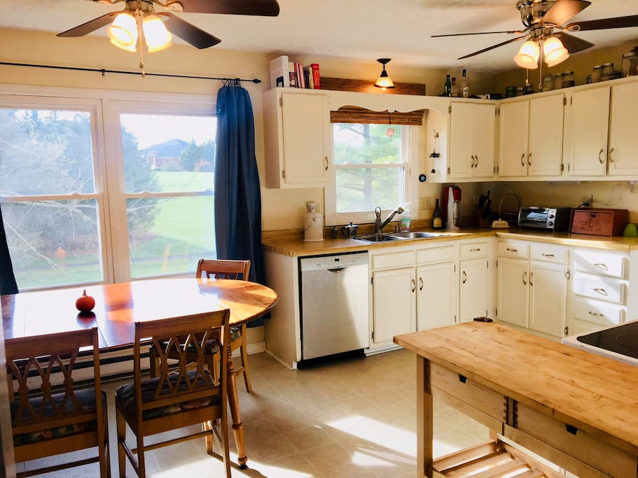 Well appointed kitchen with lots of natural light and ceiling fans. Table can be reduced to seating for four, or expanded with leaf inserts to seat eight.