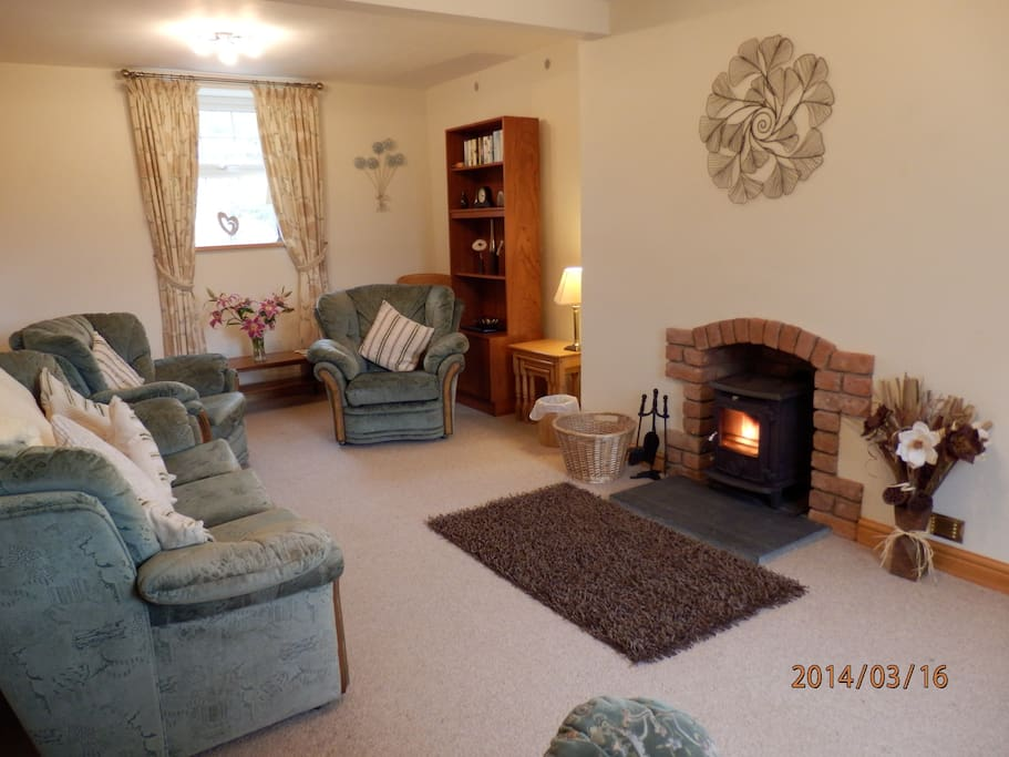 Relax in the lounge in front of the cosy woodburner
