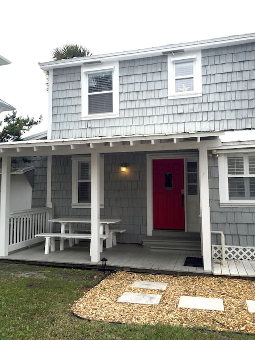 Our red front door located on Ocean Dr with a 2 car driveway