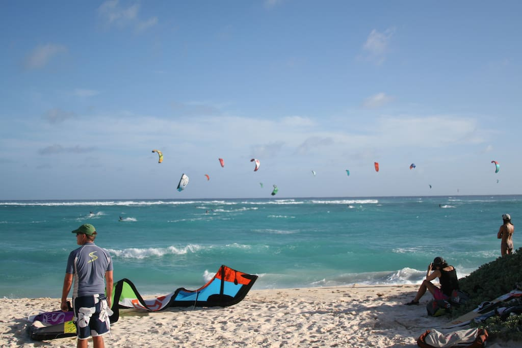 Kitesurfers close to the house