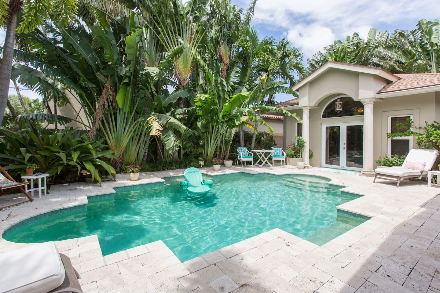 View of the pool and cabana - the back patio is quiet and relaxing and the trees and bushes surrounding the yard make it private and comfortable.