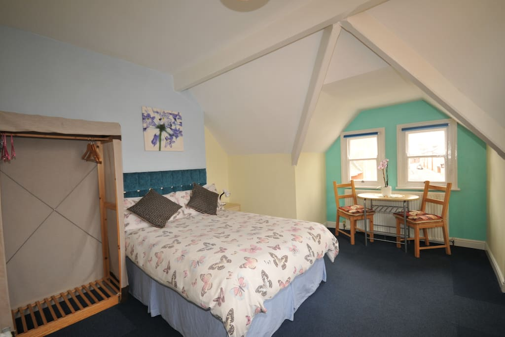 Character Attic Room, Firm Mattress, Hanging Rail, Table & Chairs. Windows (Natural Light & Ventilation).