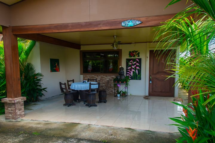 Front view of the villa. Porch with table and chairs.