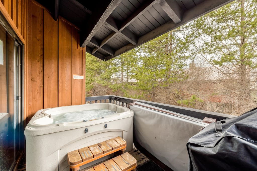 Private deck with hot tub overlooking the woods