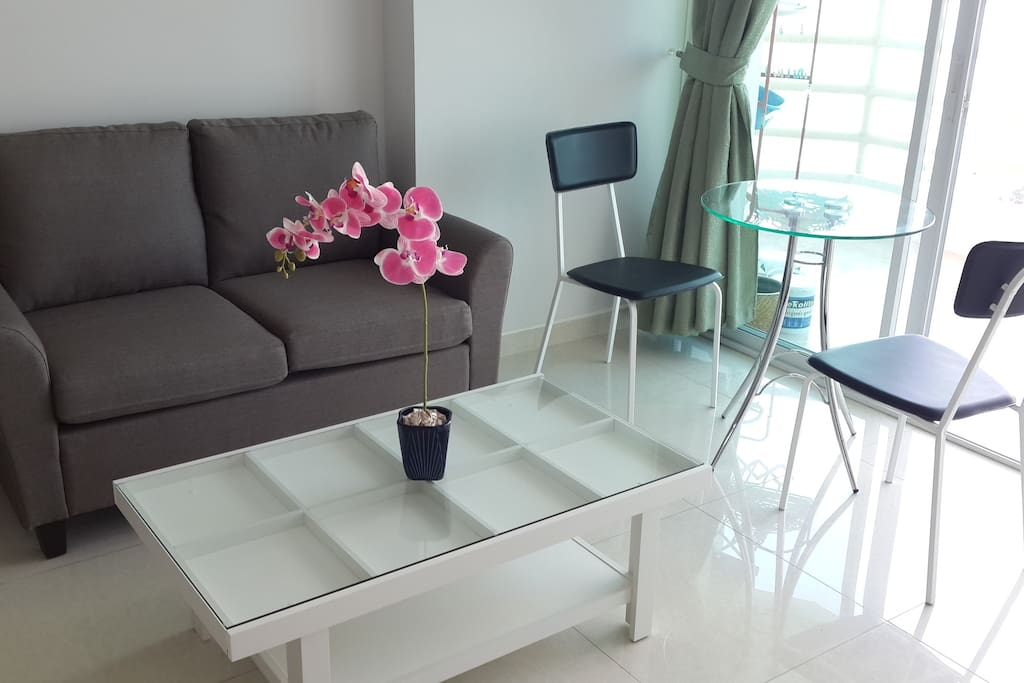 Relax in NEW sofa and enjoy your morning beverage and meals on NEW dining set