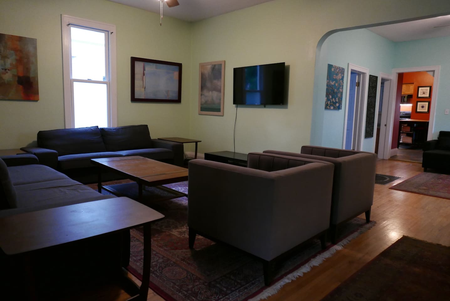 """Lots of seating in the front living room with a  50"""" 4K Smart TV and Netflix provided"""