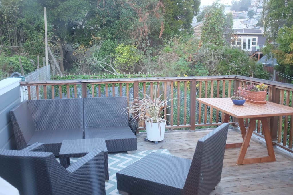 Private outdoor deck has places to relax with a book or eat meals outside
