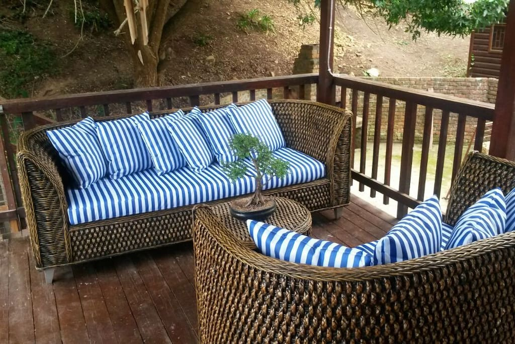 enjoy nature from wooden deck with a glass of wine