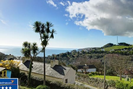 Room with view of Laxey Bay in delightful cottage