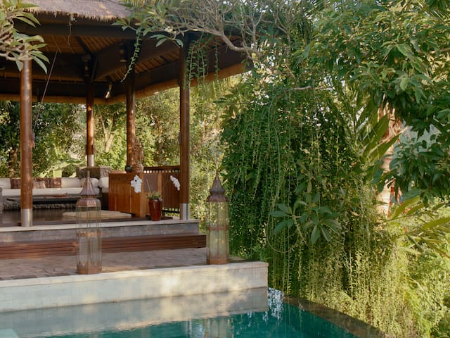 Ecoluxe'. The Hermitage Living Room. Open-Air Bali Style Living at its best.   At The Hermitage you have access to all the shared spaces, and then can return to your private Suite to take in the magnificent views of Mount Agung, stunning rice fields and the sacred Petanu River Valley.