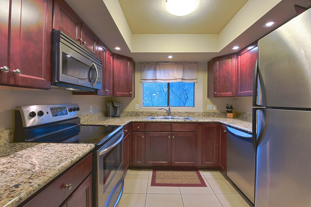 Kitchen Featuring Granite Counter Tops