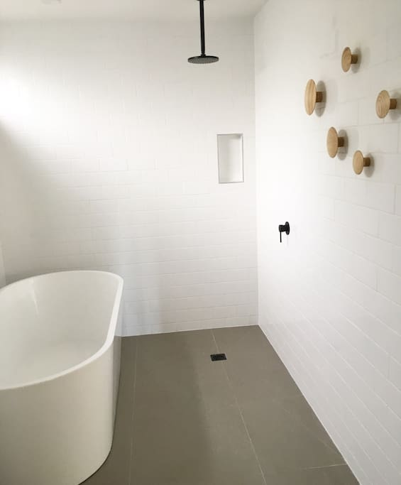 Open wet room , with high quality finishes and deep soaker bathtub, ideal for relaxing with a wine
