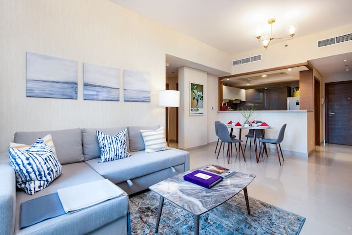 Living room with dining area and open kitchen