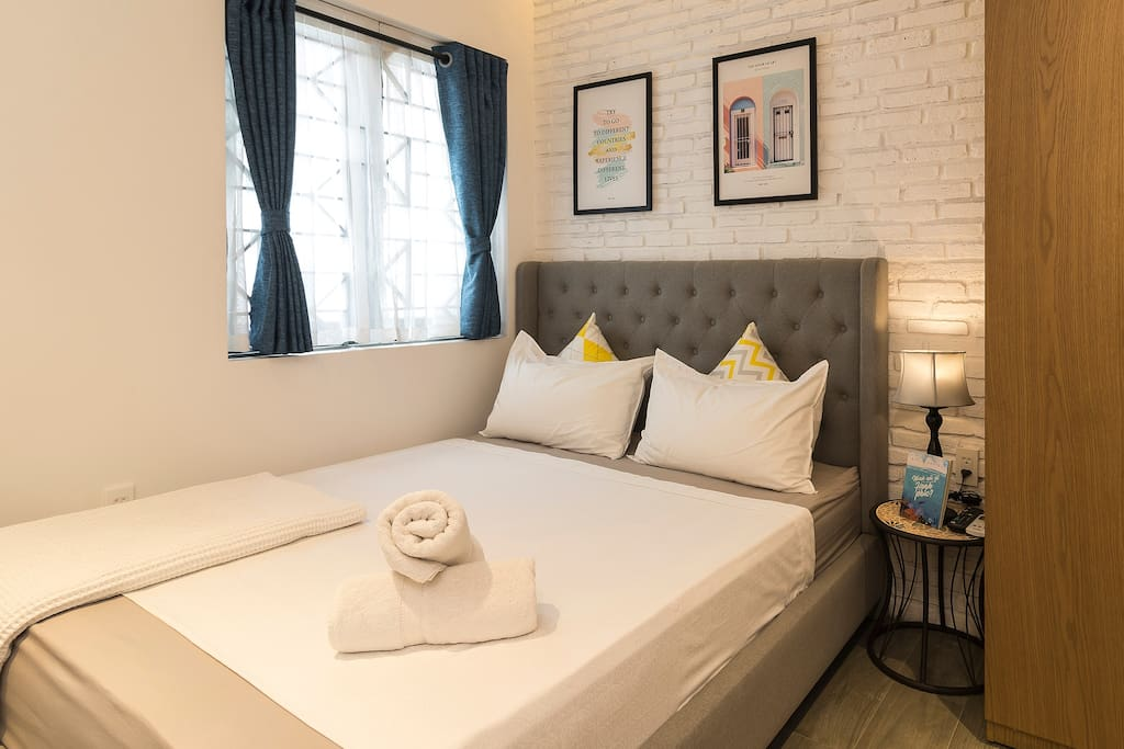 Queen-sized bed covered up by high standard Egyptian linens