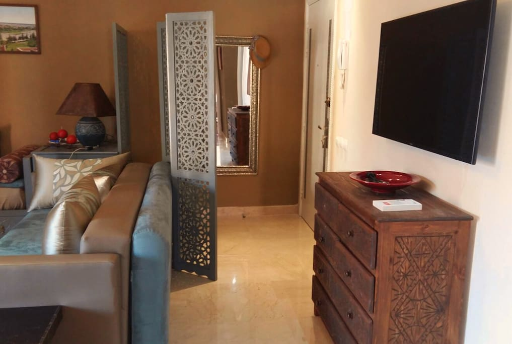 The entrance of the apartment. It is decorated with modern Moroccan style furniture