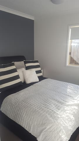 Queen Bed - Great Mattress and Ceiling Fan
