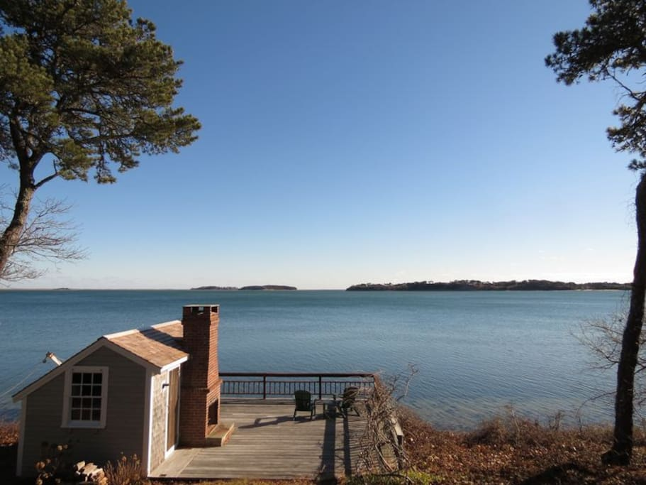 Large deck with fireplace on Pleasant Bay. It's truly one of a kind