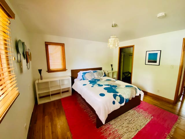 Large bedroom with a queen bed, casper mattress, and walk-in closet.