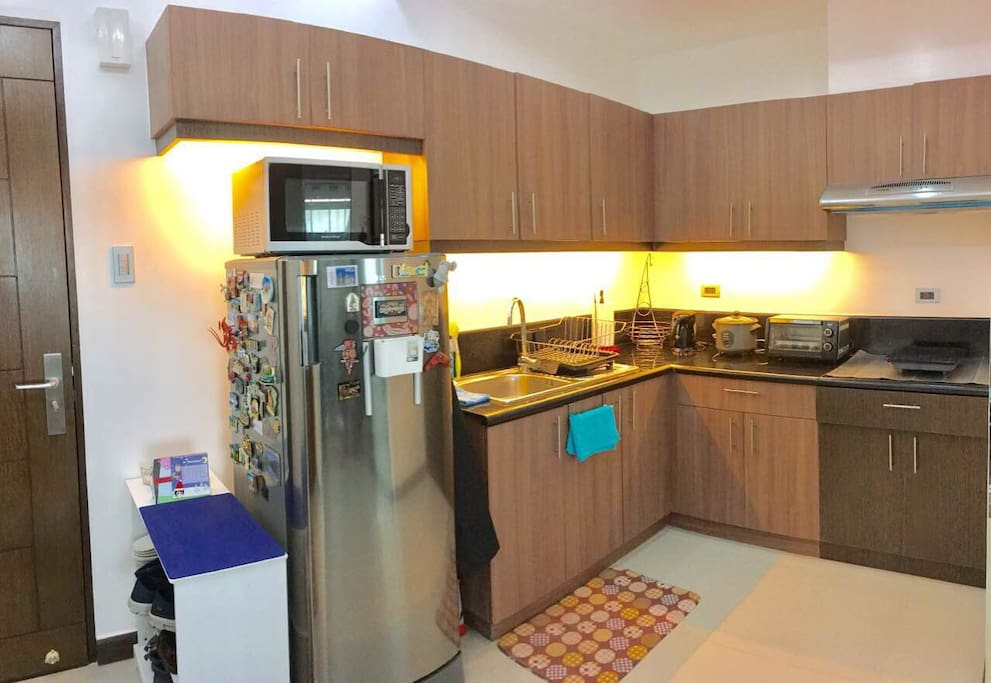 Full Kitchen, refrigerator, microvave, hot water kettle, oven toaster, rice cooker ,invection stove and complete kitchenware