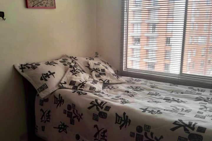 Habitación Individual en Apartamento Familiar