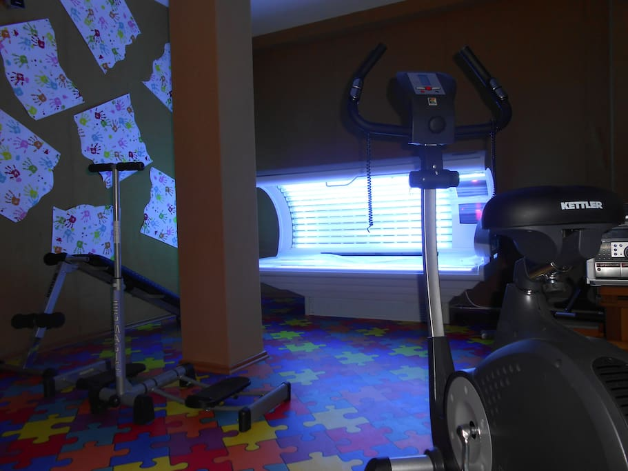 mini gym and a sun bed