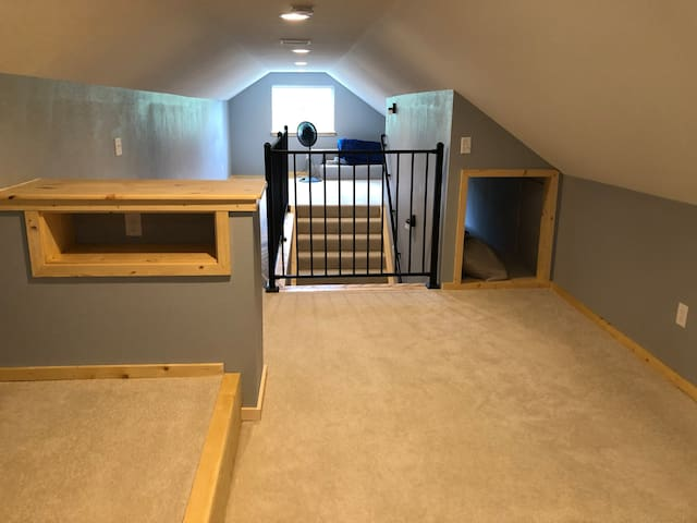 This is the upstairs, we have a very nice self inflating queen mattress and a twin couch/mattress. And a tunnel for the kids to play in.