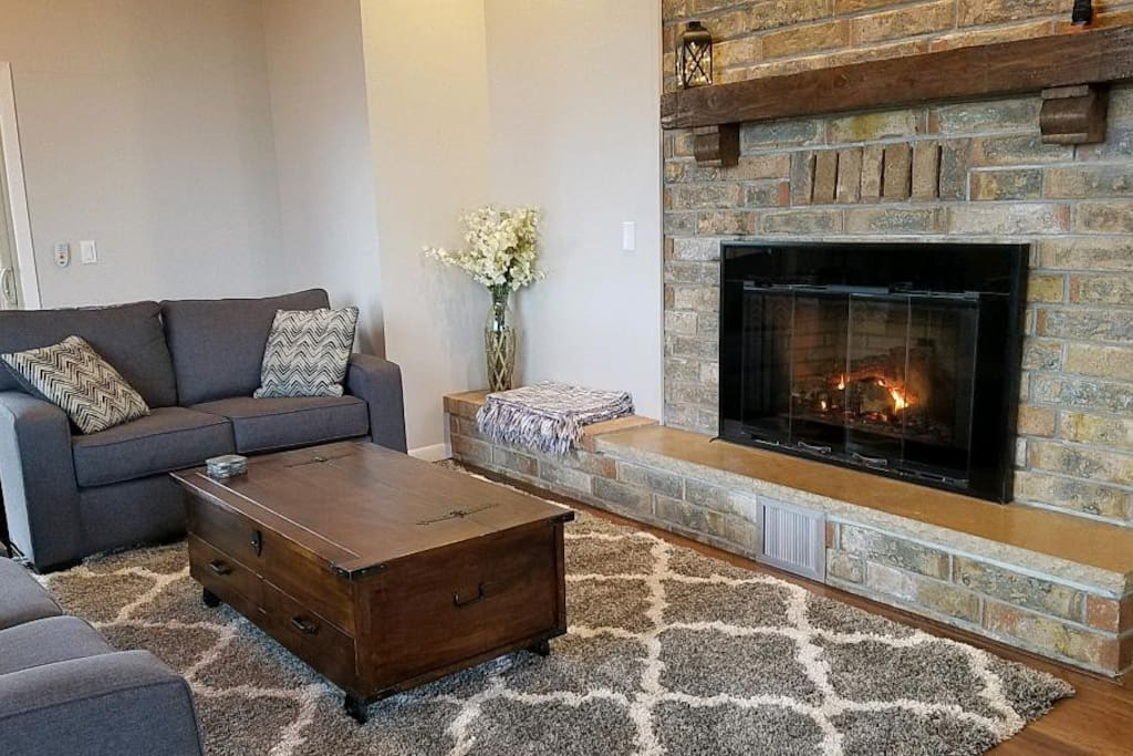 Snuggle up in front of a cozy fire!   The living room has seating for plenty of your family and friends.