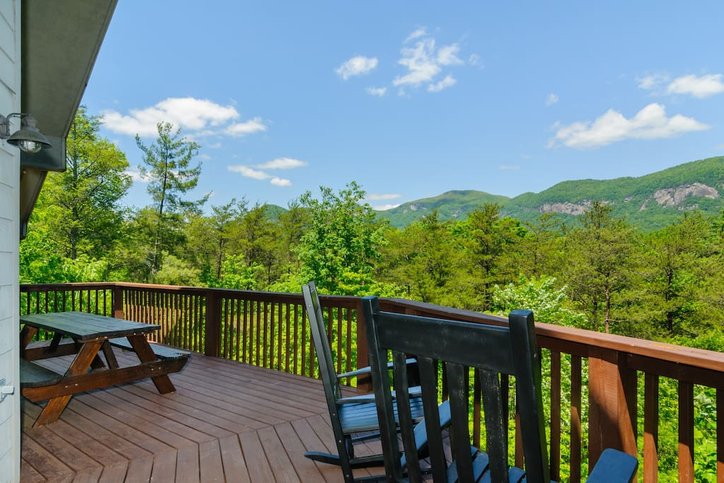 Main floor deck has picnic table, rocking chairs, charcoal grill and mountain views.