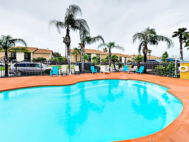 The sparkling community pool has plenty of loungers to soak up the sun.