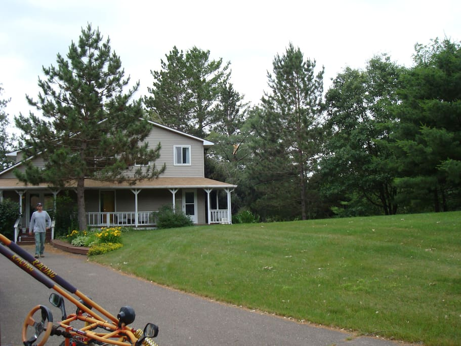 Huge yard in front, gentle river in back & miles of private trails in the woods.