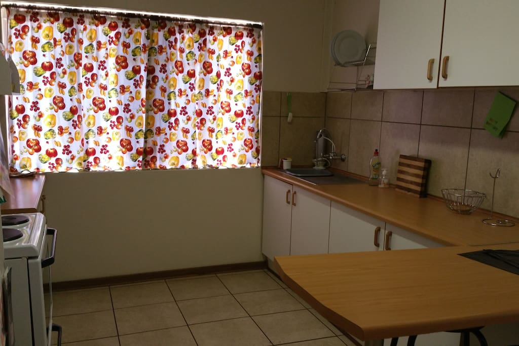 Kitchen with all basic appliances and crockery