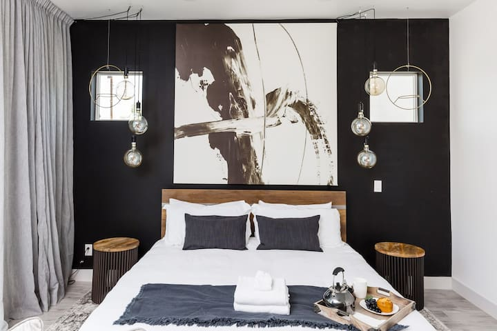 Master bedroom with an industrial chic design