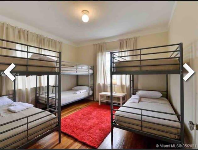 1st Floor Bedroom #2. Three bunk beds totaling 6 mattresses.
