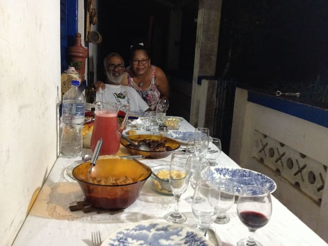 Osvaldo and Laura photographed by their guests during dinner time, using the veranda.
