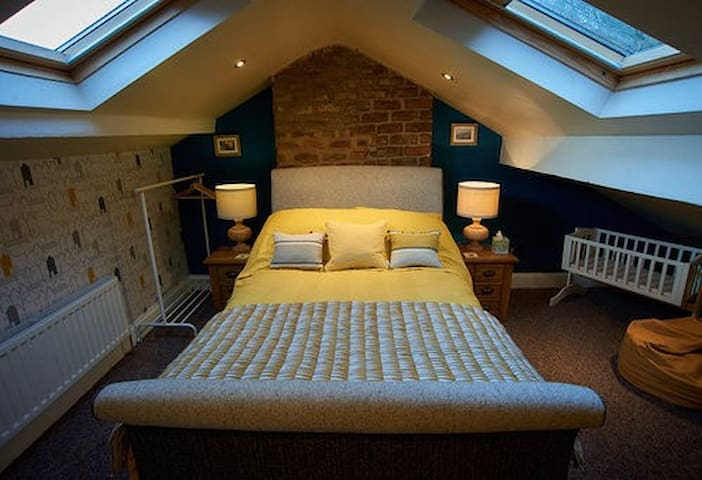 Attic bedroom with very comfortable Double Pocket Sprung bed and single bed. Plus swing crib for baby.