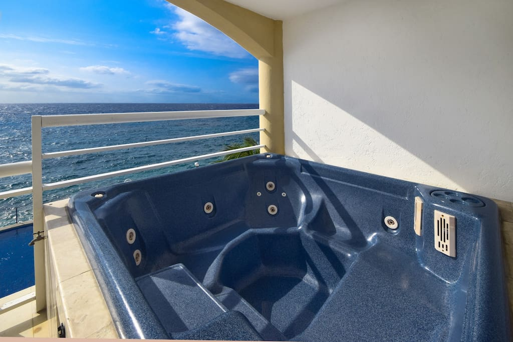 Large jacuzzi on balcony with gorgeous view