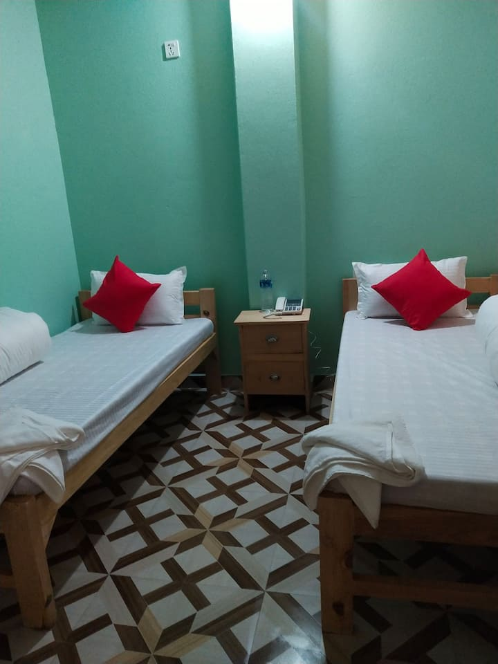 Sharing room for two people with private bathroom